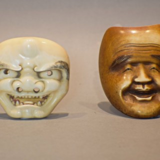 TWO JAPANESE MEIJI PERIOD IVORY NOH MASK NETSUKE - BOTH SIGNED