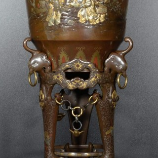 A LARGE JAPANESE MIXED METAL VASE ON STAND DEPICTING BOYS CATCHING CRICKETS