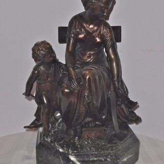 An Italian patinated bronze of mother and child
