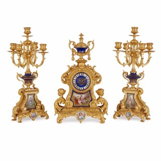 Three piece antique ormolu mounted porcelain French clock set in the Sèvres style