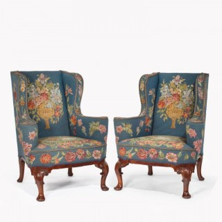 A Pair of Queen Anne style mahogany wing armchairs
