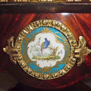 A French porcelain and ormolu mounted kingwood gueridon table