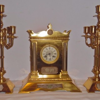 A three piece English Aesthetic movement clock set