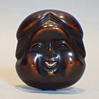 A LARGE AND CHARMING JAPANESE WOODEN NOH MASK NETSUKE OF OKAME - SIGNED
