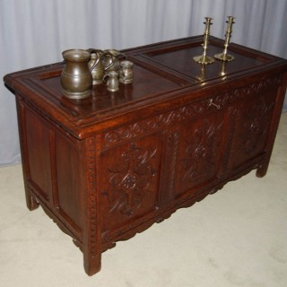 Late 18th century carved oak coffer, twin panelled, moulded top above a guilloche frieze