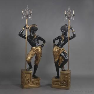 Pair of Blackamoor Figures Supporting Three-Light Candelabra