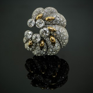A platinum, yellow gold and diamond brooch