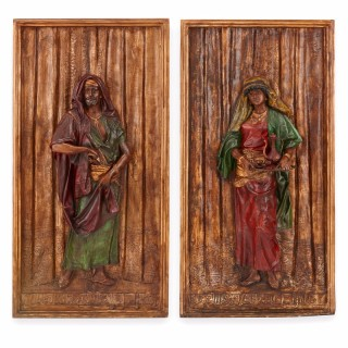 Pair of large spelter Orientalist style relief plaques by Hottot