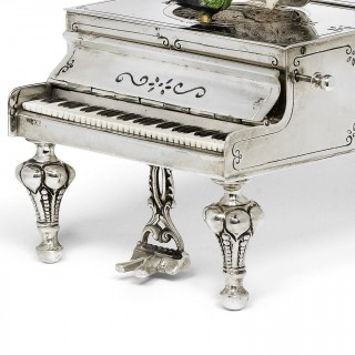 German musical bird box of silver cast in the form of a grand piano