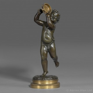 A Fine Patinated and Gilt-Bronze Figure of a Dancing Putti Holding a Tambourine