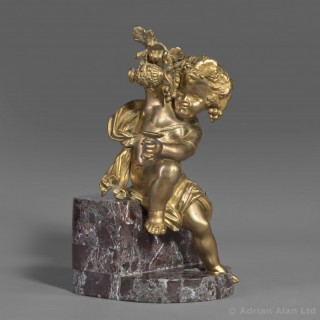 A Gilt-Bronze Bacchanalian Putto Figure