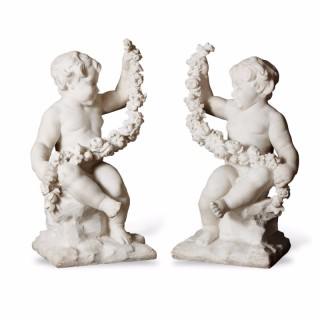 Pair of antique white marble carved cherubs in the Neoclassical style