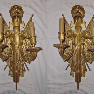 A large pair of French ormolu twin-branch wall lights