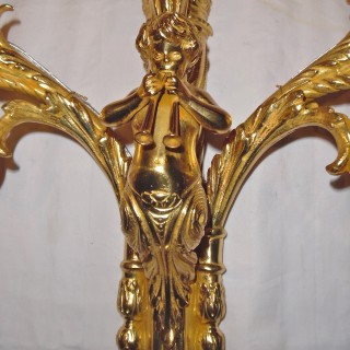 A set of eight French ormolu wall lights