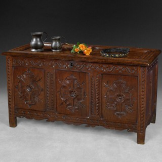Late 17th century carved oak coffer, twin panelled, moulded top above a guilloche frieze
