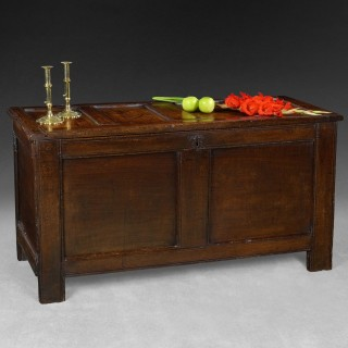 A late 17th. century oak panelled coffer