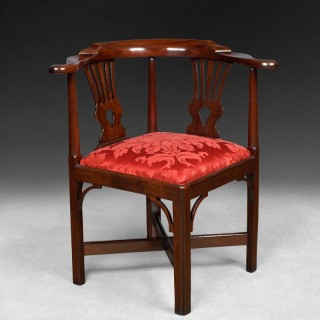 A Chippendale period mahogany corner armchair
