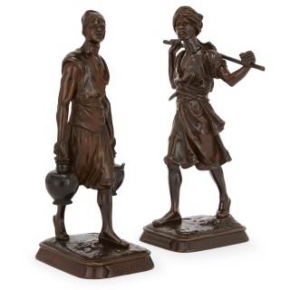 Pair of patinated bronze antique sculptures of Orientalist figures