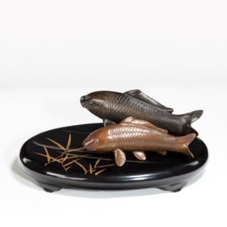 Two Meiji period bronze carp,