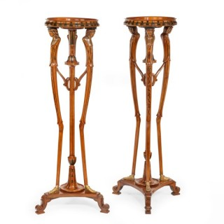 pair of late Victorian painted satinwood and ormolu tripod stands