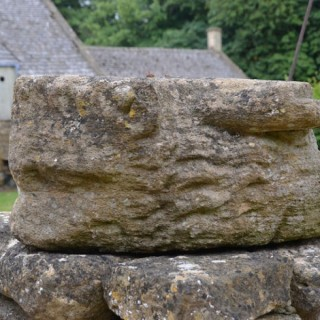 A medieval Ham stone gargoyle in the form of a lion or mythical beast.