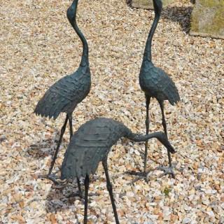 A set of three Taisho period (1912-1926) Japanese bronze cranes