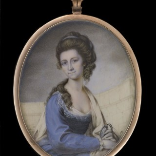 Portrait miniature of the artist's wife Anne Jean (née Noel) (1758-1787), holding a miniature of her husband in her left hand, wearing lace-trimmed blue dress with white fichu and stole over left shoulder, her dark brown upswept hair dressed with a blue r
