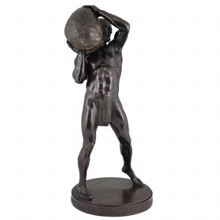 Antique bronze sculpture of a male nude athlete with stone.