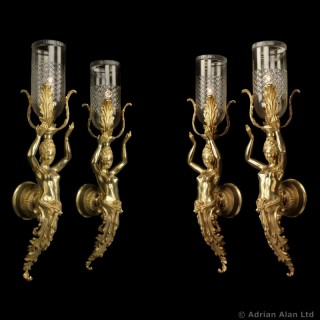 Set of Four Large Gilt-Bronze Figural Wall Appliques