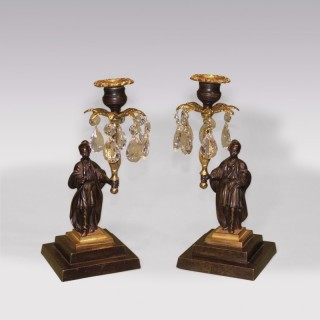A Pair of early 19th Century Chinamen bronze & ormolu Lustre Candlesticks.