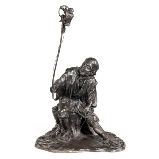 A Meiji period bronze group of a monkey trainer by Seiya