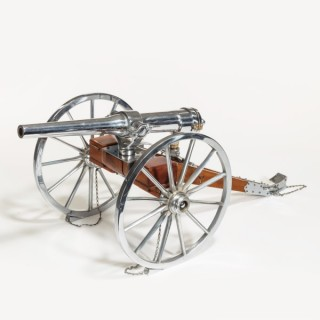 a fine mahogany and nickel plated scaled model of a British Artillery field Cannon by Whatley Kirk and co.  Circa 1899
