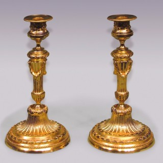 A Pair of Louis XVI style ormolu Candlesticks.