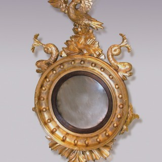 A 19th Century carved giltwood Convex Mirror.