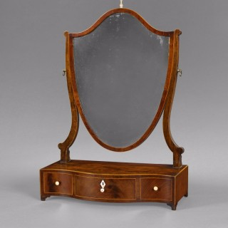 George III Mahogany and inlaid Shield shaped toilet mirror