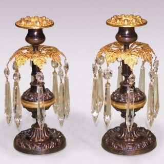 Pair of 19th Century bronze and ormolu Lustre Candlesticks.