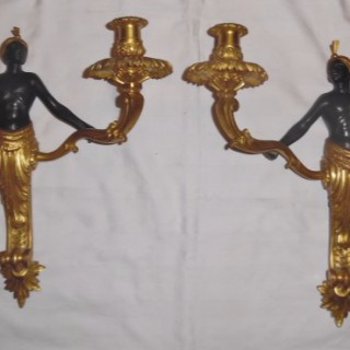 A pair of French blackamoor twin wall lights