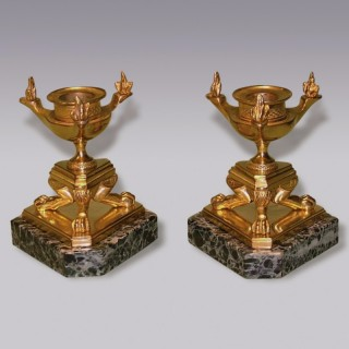 Pair of 19th Century ormolu Candlesticks on marble.