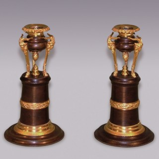 Pair of Regency bronze & ormolu & ram's head Candlesticks.