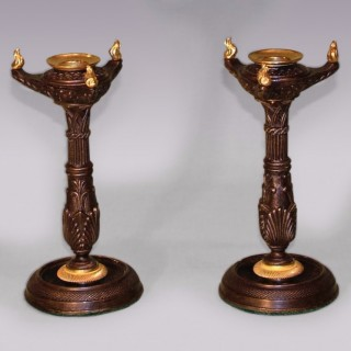 Pair of Regency period bronze and ormolu gothic Candlesticks.