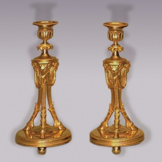 A well cast pair of mid 19th Century ormolu Candlesticks.