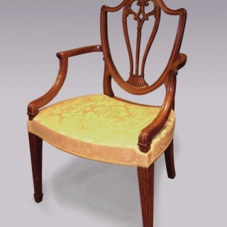A Hepplewhite period well-carved mahogany Armchair.