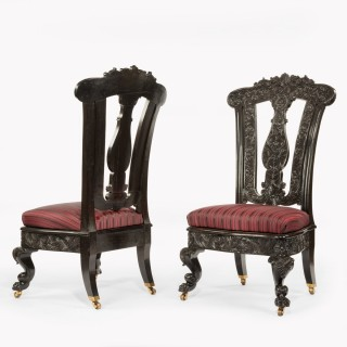 A very fine pair of Ceylonese solid ebony hall chairs