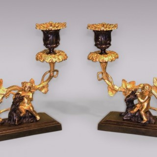 Pair of 19th Century bronze and ormolu Cherub and Ram Candlesticks.