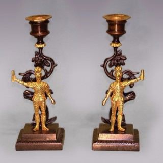 A pair of 19th Century bronze and ormolu knight Candlesticks.