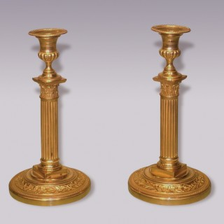 A pair of late 18th Century French ormolu Candlesticks.