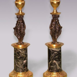 Pair of early 19th Century bronze and ormolu 'classical lady' Candlesticks.