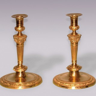 Pair of Louis XVI Style ormolu Candlesticks with lion's head decoration.