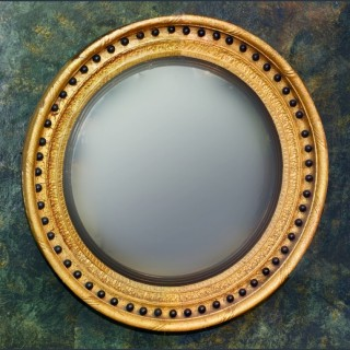 A large Regency period giltwood and ebony Convex Mirror circa 1820