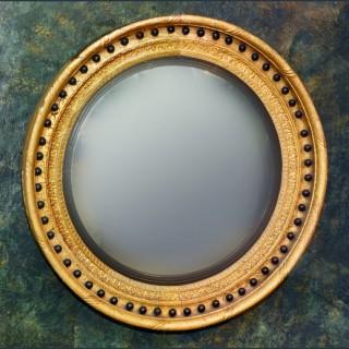 A large Regency period giltwood and ebony Convex Mirror circa 1820